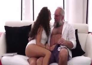 Nice-looking stepdaughter slowly sucks her daddy's dick