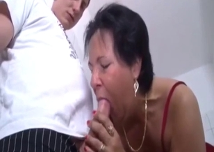 Young man with hard prick drills his mom's throat