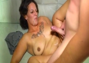 Busty tattooed mom fucks with her son